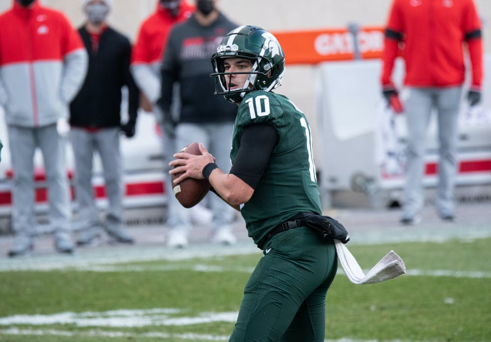 MSU's quarterback Payton Thorne, from Naperville, IL, looks downfield in a game against OSU on Dec. 5, 2020.