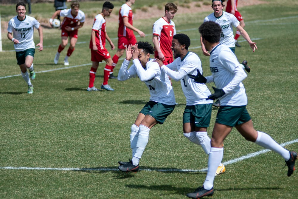 Olu Ogunwale (14) of the Spartans celebrating his goal in the game against Wisconsin on March 31st, 2021 at DeMartin Stadium in East Lansing.