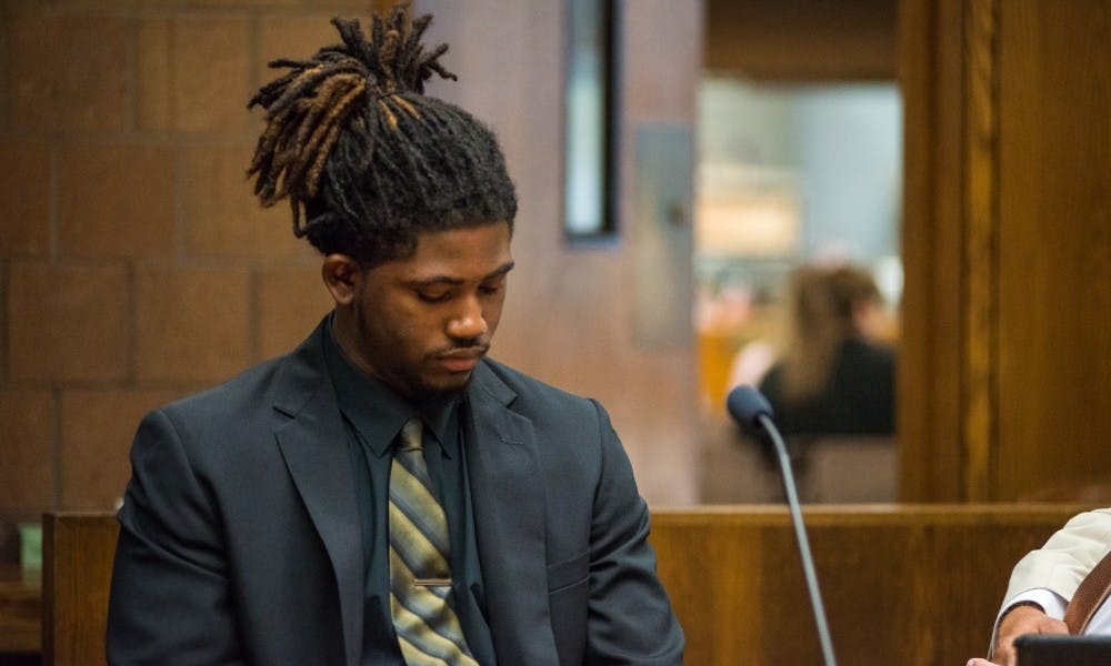<p>Former MSU football player Auston Roberston looks to the ground on June 22, 2017, at the 55th District Court in Mason, Michigan. At the hearing Judge Thomas P. Boyd ordered an additional count of third-degree criminal sexual conduct be charged against Robertson for his alleged role in a sexual assault in April.</p>