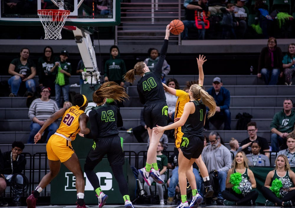 Freshman guard Julia Ayrault (40) swats away a shot during the game against Minnesota Feb. 17, 2020 at the Breslin Center.