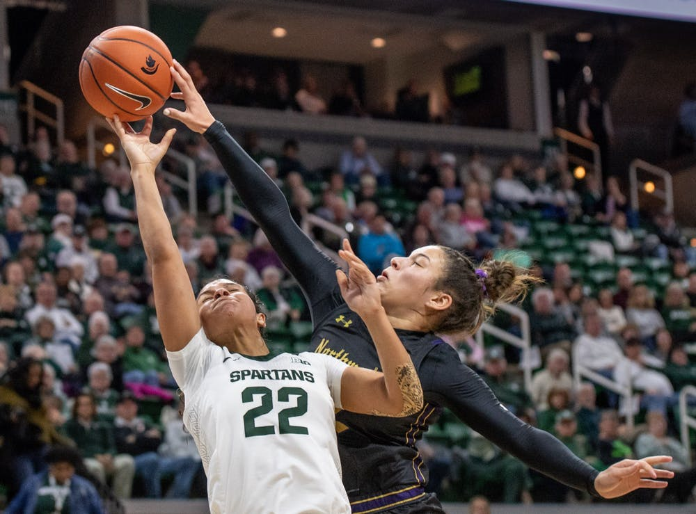 <p>Freshman forward Taiyier Parks (14) shoots from underneath the basket during the game against Northwestern Jan. 23, 2020 at the Breslin Center. The Spartans fell to the Wildcats, 76-48.</p>