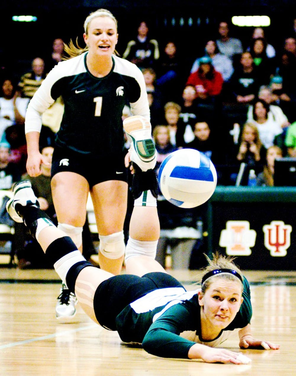 Redshirt senior outsider hitter and middle blocker Jenilee Rathje  falls to the floor after attempting to dig the volleyball. The Spartans fell against the Boilermakers, 3-1, Saturday night at Jenison Field House. Justin Wan/The State News