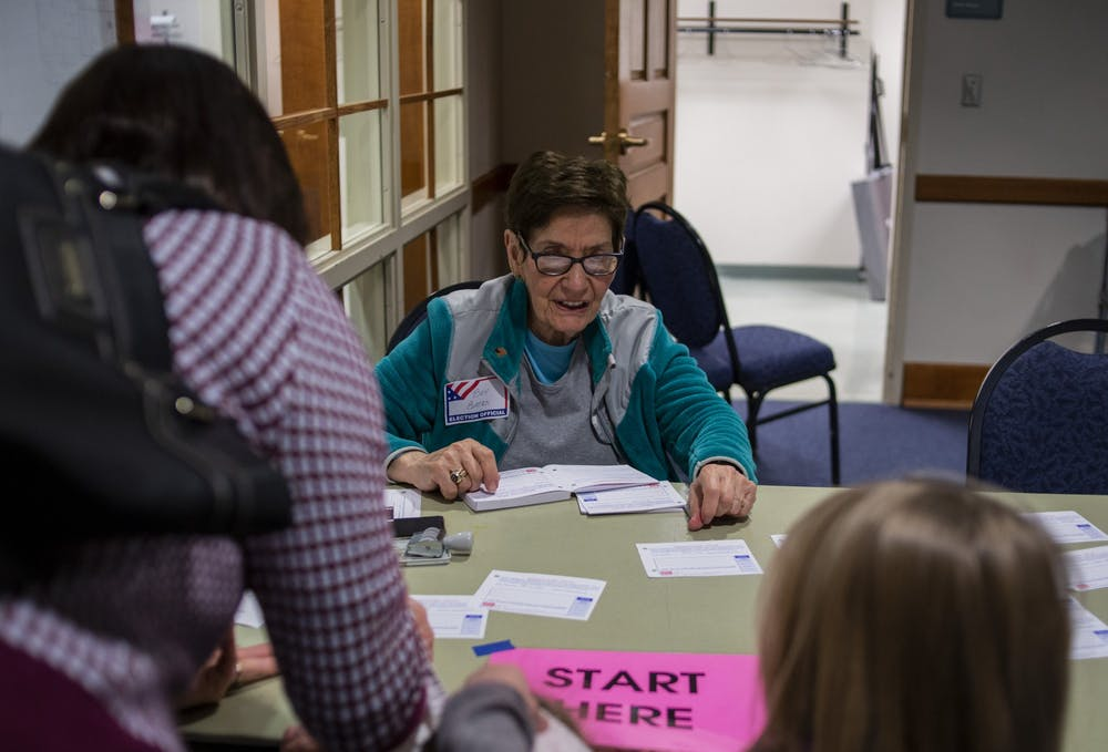 East Lansing resident and volunteer Bev Baten helps people vote in the East Lansing City Council Election at Hannah Community Center on Nov. 5, 2019.