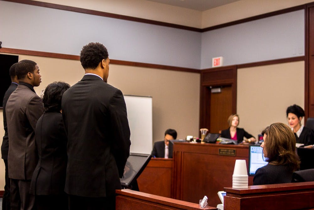 <p>Joshua King, Donnie Corley and Demetric Vance face Judge Rosemarie Aquilina during the pretrial conference on April 4, 2018 at Veterans Memorial Courthouse in Lansing.</p>