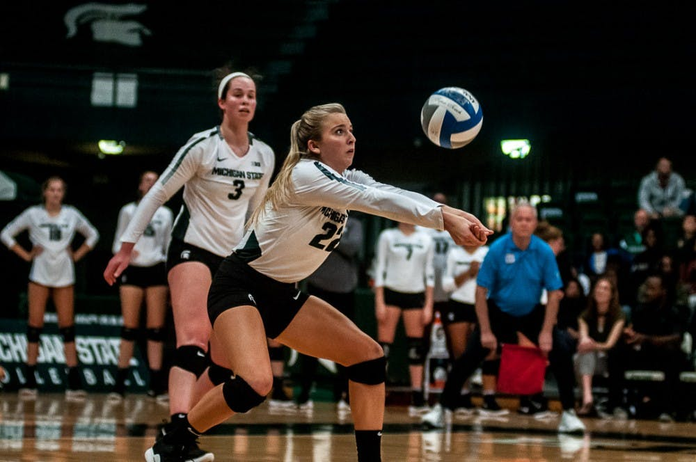 <p>Defensive specialist and libero Samantha Mclean (22) sets the ball during the game against Rutgers on Sept. 29, 2018 at Jenison Fieldhouse. The Spartans beat the Scarlet Knights, 3-1.&nbsp;</p>