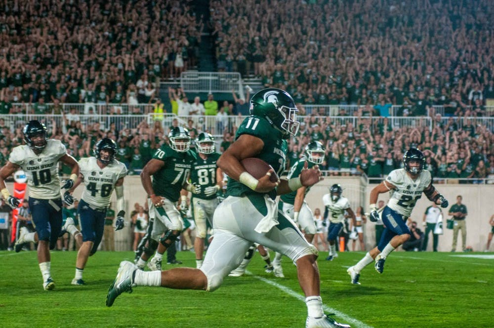 Sophomore tailback Connor Heyward (11) runs down the field during the game against Utah State on Aug. 31 at Spartan Stadium. The Spartans defeated the Aggies; 38-31.