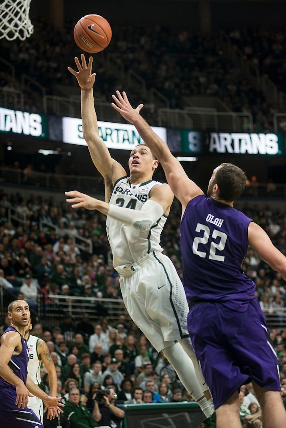 <p>Sophomore forward Gavin Schilling attempts a point over Northwestern center Alex Olah Jan. 11, 2015, during the game against Northwestern at Breslin Center.  The Spartans defeated the Wildcats, 84-77 in overtime. Erin Hampton/The State News</p>
