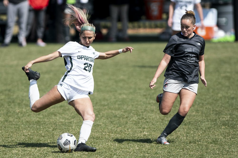 <p>Freshman defense Zivana Labovic (20) kicks the ball past an Ohio State player during the game against Ohio State on April 3, 2021, at DeMartin Stadium. The Buckeyes defeated the Spartans, 1-0.</p>