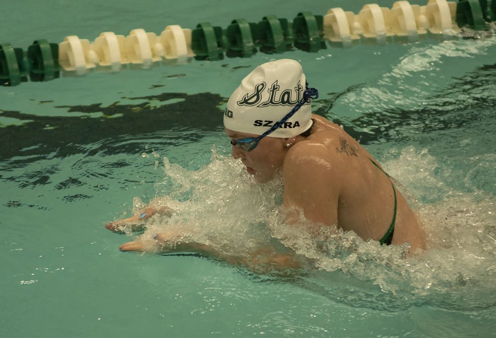 Erin Szara, junior, participates in the women's 100m breaststroke. Michigan State hosted the swim and dive meet against Oakland on January 18.
