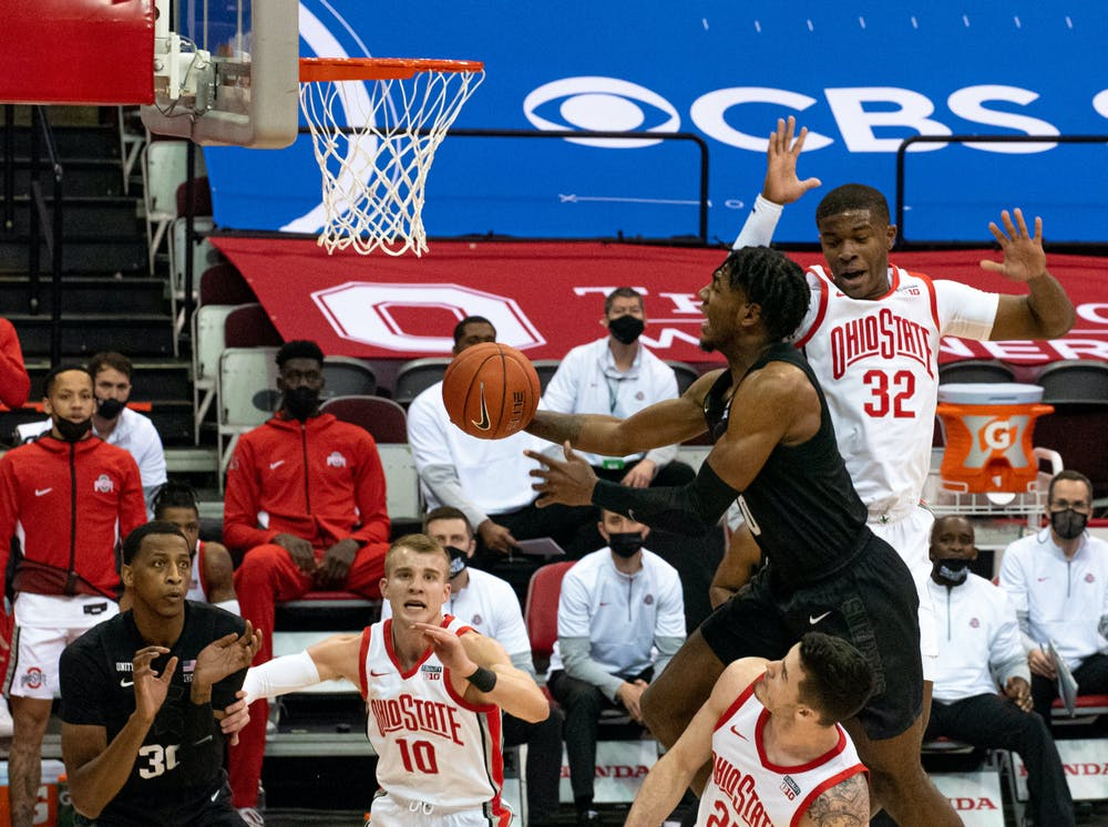 <p>Aaron Henry (0) takes a leap towards Ohio State&#x27;s basket in the first half but is unsuccessful. The Buckeyes swept the Spartans 79-62 at OSU&#x27;s Schottenstein Center on Jan. 31.</p>