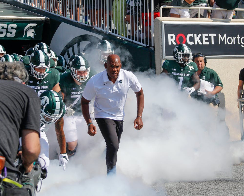 <p>Head coach Mel Tucker leads the team onto the field ahead of their home opener for the 2021 season. Photographer on Sept. 11, 2021.</p>