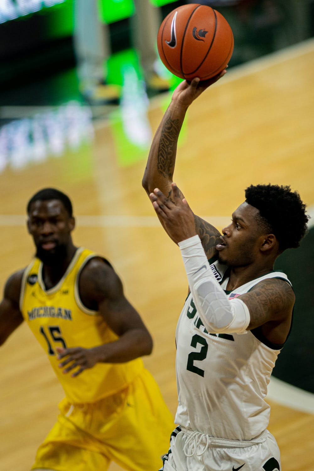 <p>Sophomore guard Rocket Watts (2) shoots a floater during the Spartans&#x27; 70-64 upset on the No. 2 Wolverines on March 7, 2021. Watts led all players in scoring with 21 points.</p>