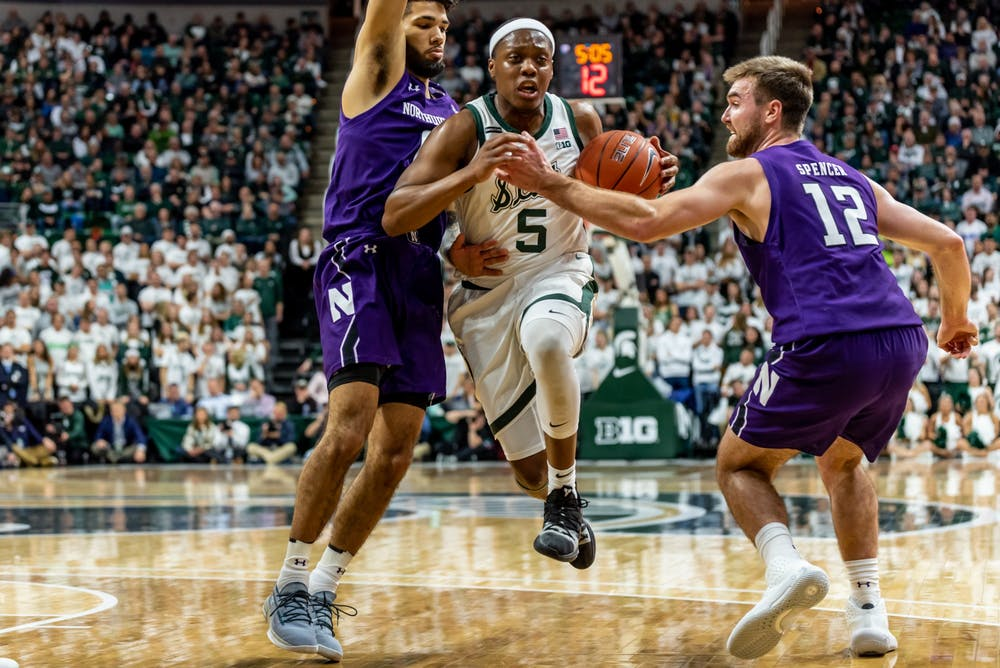 Senior Guard Cassius Winston (5) cuts through the Northwestern defense.