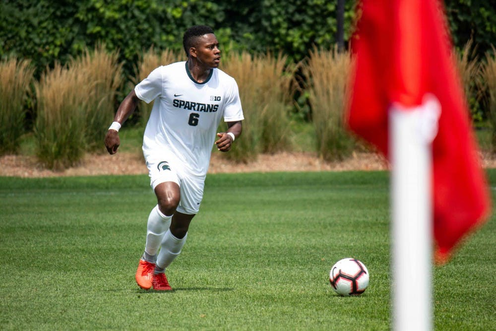<p>Senior forward DeJuan Jones (6) dribbles the ball during the exhibition match against Western Michigan on Aug. 13, 2018 at DeMartin Soccer Stadium. The Spartans tied with the Broncos, 1-1.</p>
