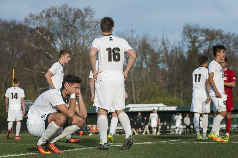 Sophomore forward Hunter Barone (7) reacts to SIUE scoring the winning shot of the game during the NCAA tournament on Nov. 17, 2016 at DeMartin Stadium. The Spartans were defeated by the Cougars in a shoot out, 9-8.