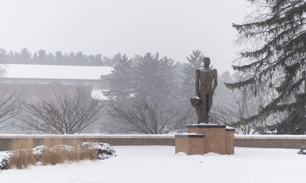 <p>The Spartan Statue gets a dusting of snow on Jan. 28, 2019. Lansing Mayor Andy Schor declared a snow emergency on the same day due to the inclement weather.</p>