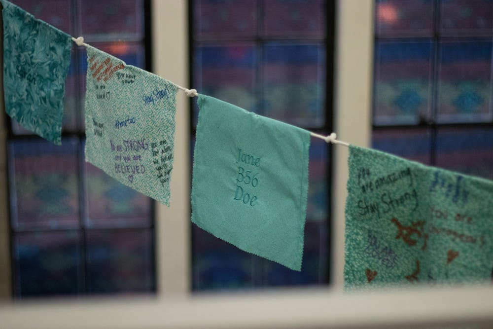 Tibetan prayer flags hang in the MSU Museum on Jan. 15, 2019. These symbolize support for sexual assault and abuse survivors.