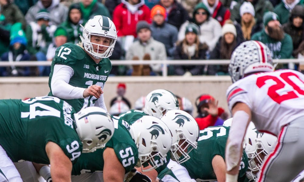 <p>Redshirt freshman quarterback Rocky Lombardi (12) looks down the offensive line during the game against Ohio State Nov. 10, 2018. The Spartans fell to the Buckeyes, 26-6.</p>