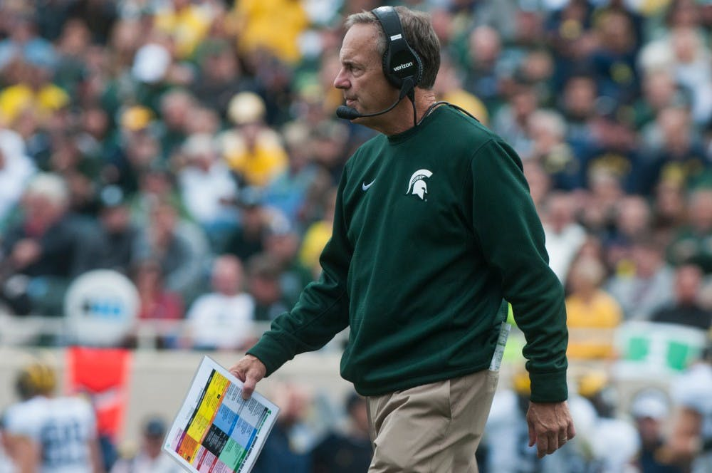 Head coach Mark Dantonio walks back to the sidelines after talking with the team during a time out during the game against Michigan on Oct. 29, 2016 at Spartan Stadium. The Spartans were defeated by the Wolverines, 32-23.