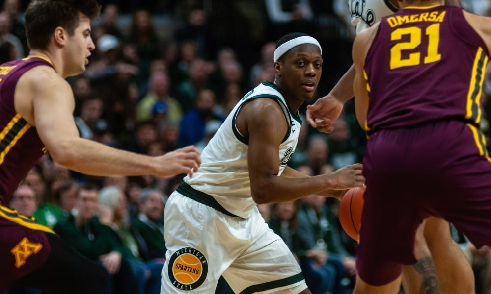 <p>Junior guard Cassius Winston looks to pass the ball against Minnesota. MSU beat Minnesota 79-55 at the Breslin Center on Feb. 9, 2019.</p>