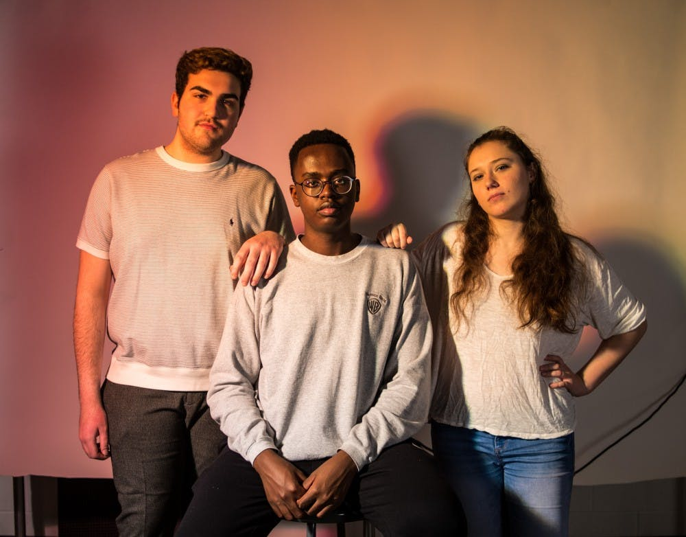 From left to right, political science sophomore Carter Oselett, social relations and policy sophomore Baraka Macharia and computer science junior Jillian Tosolt pose under studio lights on Feb. 12, 2019.