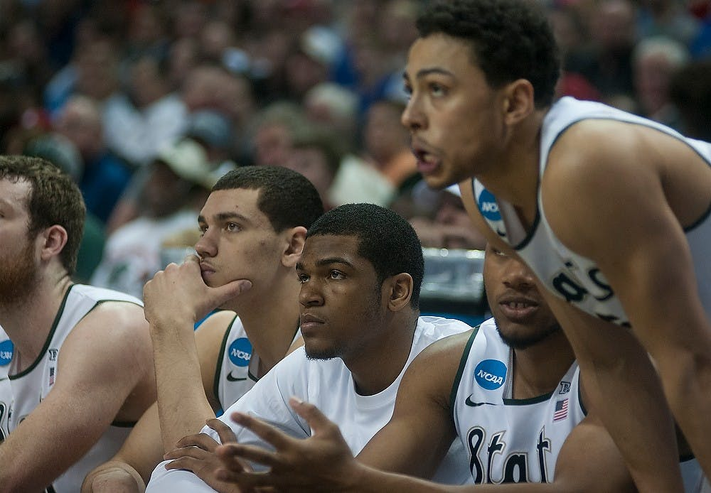 <p>The team watches from the bench Mar. 20, 2015, during the second round of the NCAA tournament in a game against Georgia at the Time Warner Cable Arena in Charlotte, North Carolina. The Spartans defeated the Bulldogs, 70-63. Alice Kole /The State News</p>