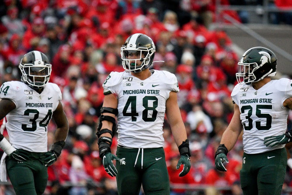 <p>Freshman running back Anthony Williams Jr. (34), senior defensive end Kenny Willekes (48) and senior linebacker Joe Bachie (35) during the game against Wisconsin at Camp Randall Stadium on Oct. 12, 2019. The Spartans lost to the Badgers 38-0. </p>