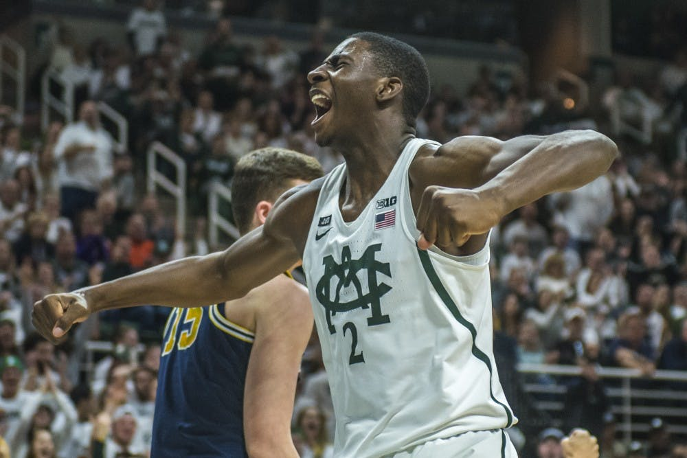 Freshman forward Jaren Jackson Jr. (2) expresses emotion after making a dunk during the first half of the men's basketball game against Michigan on Jan. 13, 2018 at Breslin Center. The Spartan's led the first half, 37-34. (Nic Antaya | The State News)