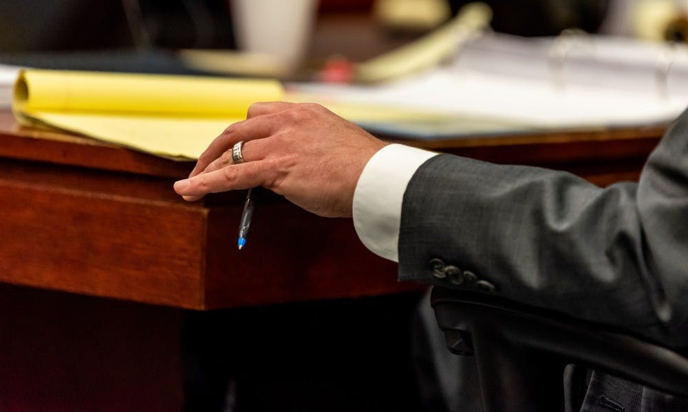 Defense attorney John Dakmak looks over his notes during the trial of Dr. William Strampel, former dean of the MSU College of Osteopathic Medicine, at the Ingham County Circuit Court on June 4, 2019.