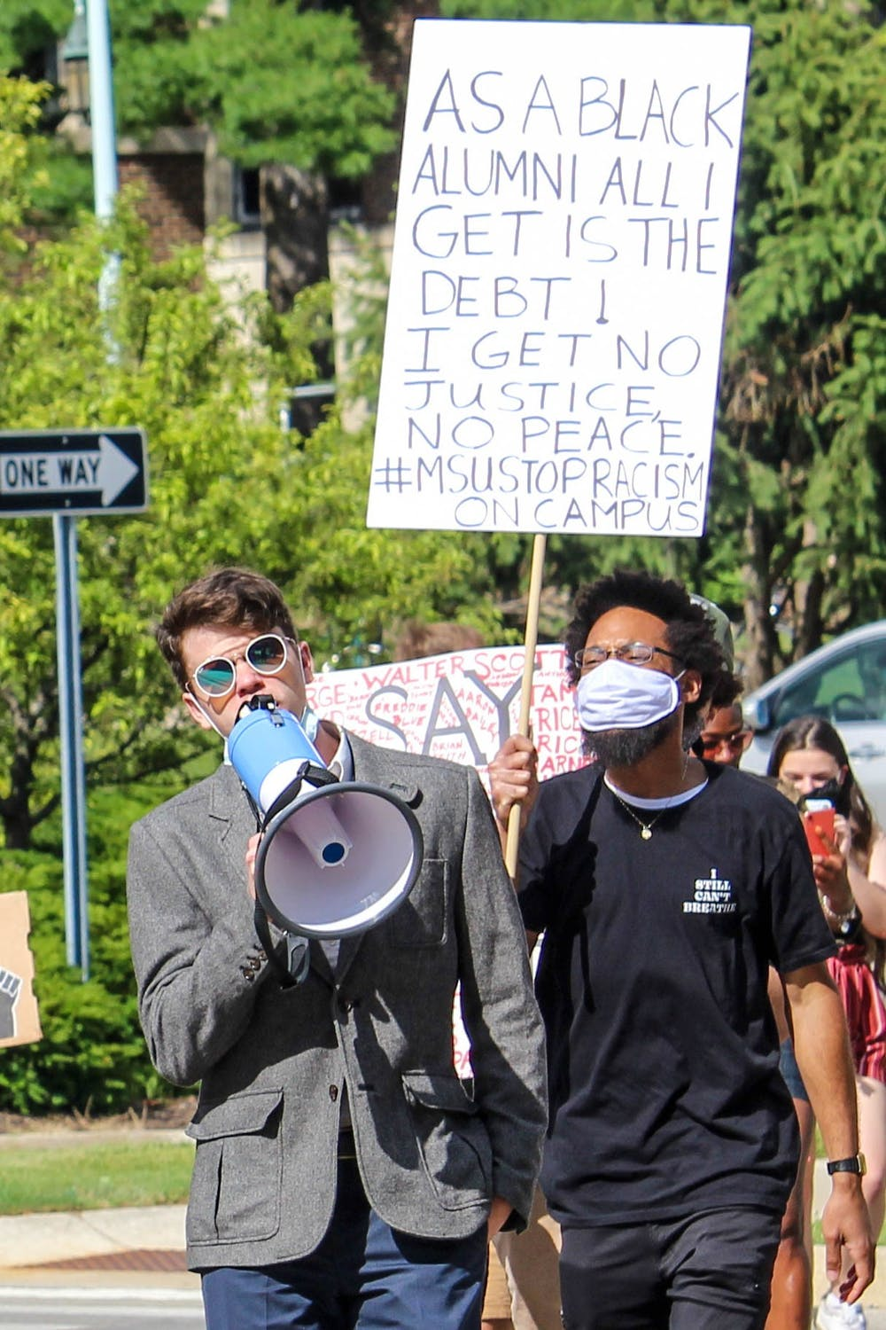<p>Edmund Rushton and Tory Conway lead the &quot;March Against Fear&quot; from ELPD to Cowles House on June 24, 2020.</p>