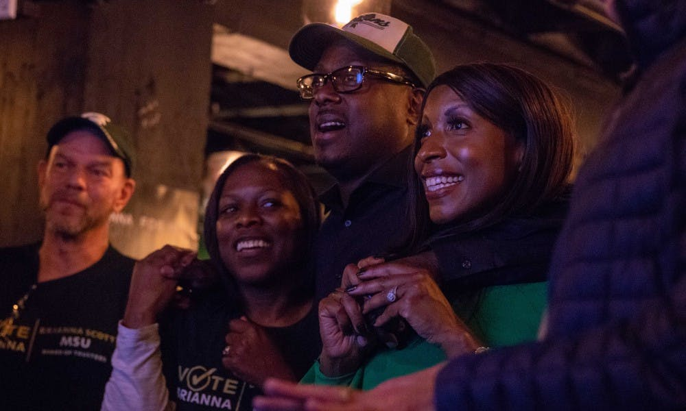 <p>Newly-elected Trustee Brianna Scott watches results come in at her watch party with friends and family at Smash Wine Bar and Bistro in Muskegon, Nov. 6.&nbsp;</p>