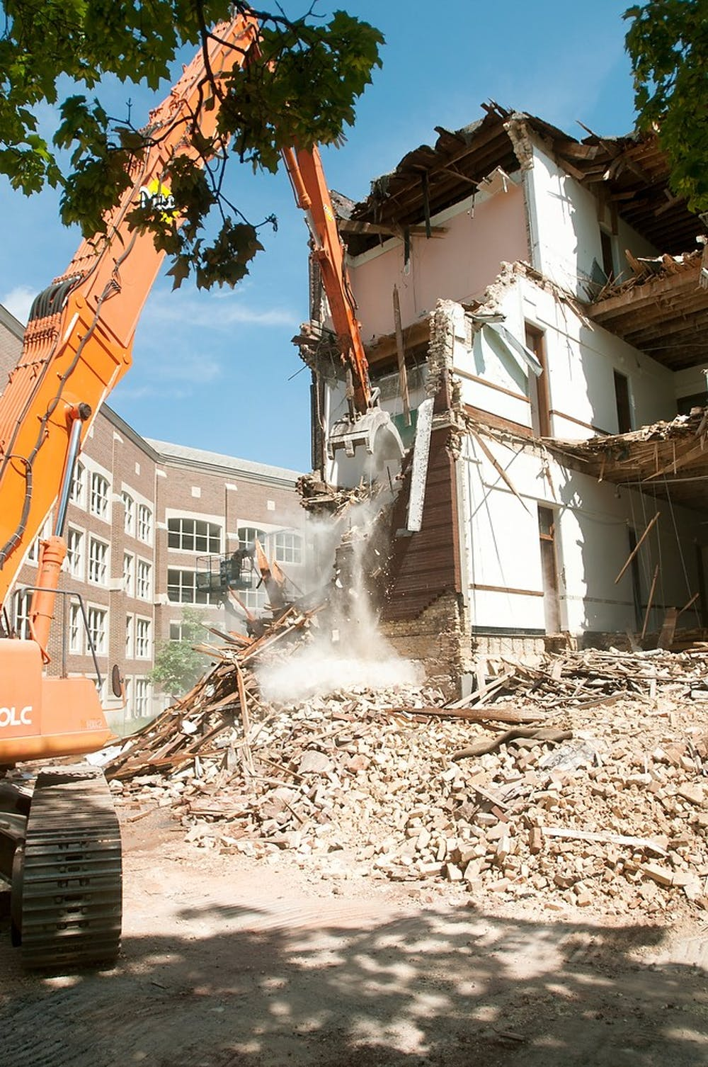 <p>Morrill Hall demolition continues June 4, 2013. Demolition started June 3, 2013. Weston Brooks/The State News</p>