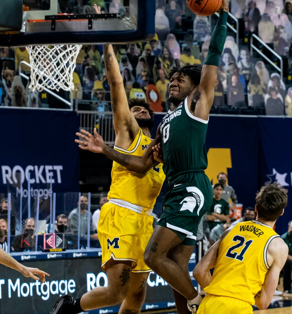<p>Junior forward Aaron Henry (0) makes the first basket for Michigan State in the first half of the game. The Wolverines crushed the Spartans, 69-50, at Crisler Center on March 4, 2021.</p>