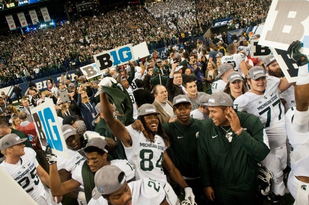 The Spartan football team and Spartan fans celebrate on Dec. 5, 2015 after the Big Ten championship game against Iowa at Lucas Oil Stadium in Indianapolis. The Spartans defeated the Hawkeyes 16-13.