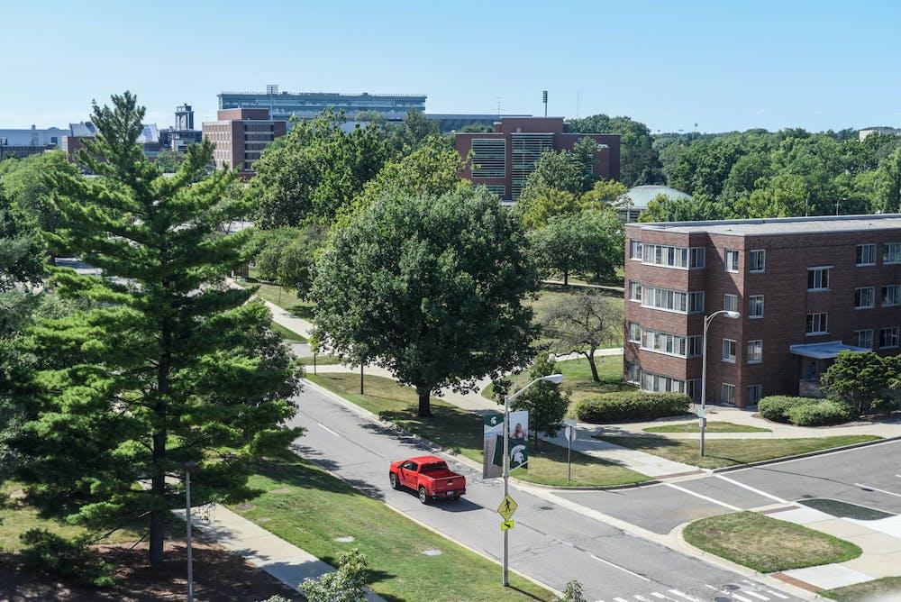 A car drives through campus on Aug. 11, 2020.