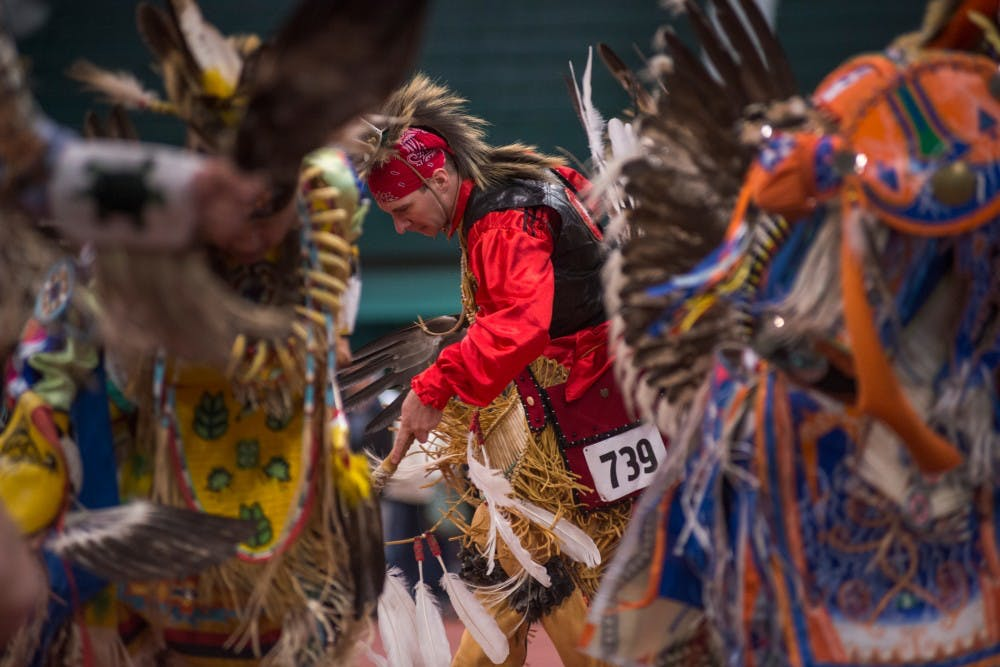 Cherokee descendant Jake Reed dances during a pow wow on April 9, 2016 at the Jenison Field House. This event was put on by North American Indigenous Student Organization which strives to promote education and motivate the Native Student Community at MSU.