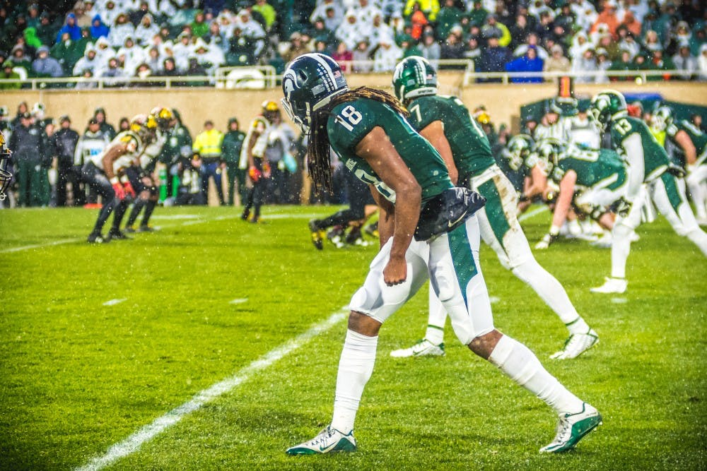 Junior wide receiver Felton Davis III (18) lines up before a play during the game against Maryland on Nov. 18, 2017, at Spartan Stadium. The Spartans defeated the Terrapins, 17-7.