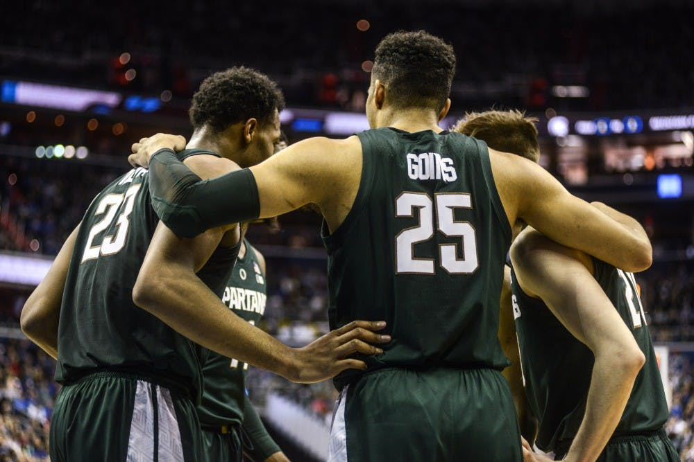 The Spartans huddle during the game against Duke at Capital One Arena on March 31, 2019. The Spartans defeated the Blue Devils, 68-67. The Spartans are the East Regional Winners and are headed to the Final Four.