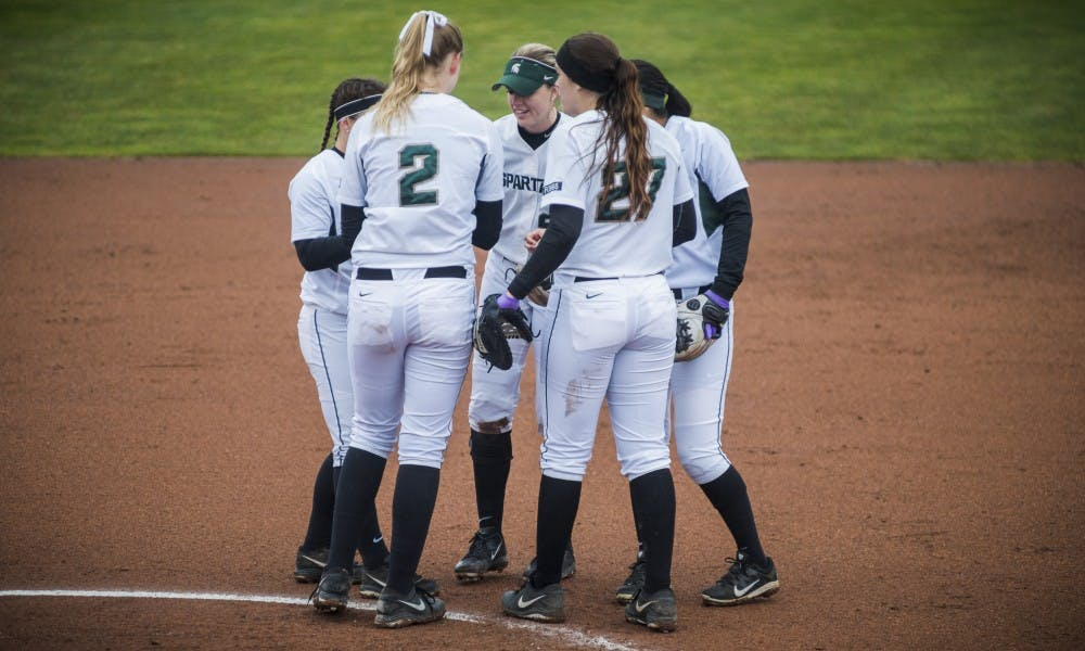 The Spartans gather to talk during the game against Maryland on March 31, 2017 at Secchia Stadium. The Spartans defeated the Terrapins, 11-3.