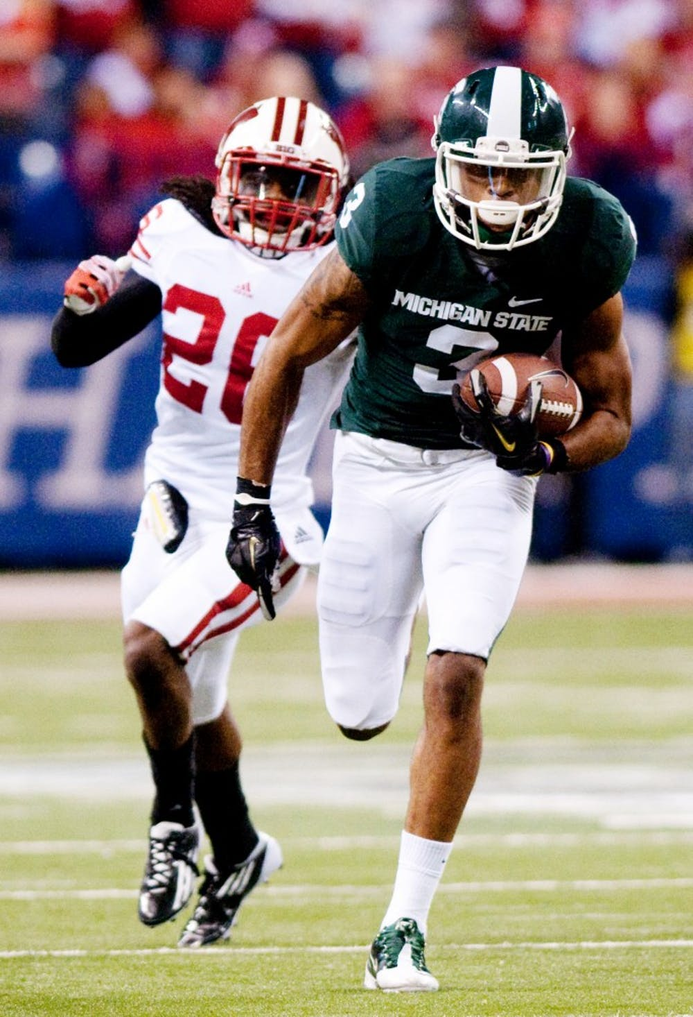 Senior wide receiver B.J. Cunningham breaks into the open field after pulling in a catch. The Spartans lost to the Wisconsin Badgers, 42-39, in the Big Ten Championship game on Saturday night at Lucas Oil Stadium in Indianapolis, Ind. Josh Radtke/The State News