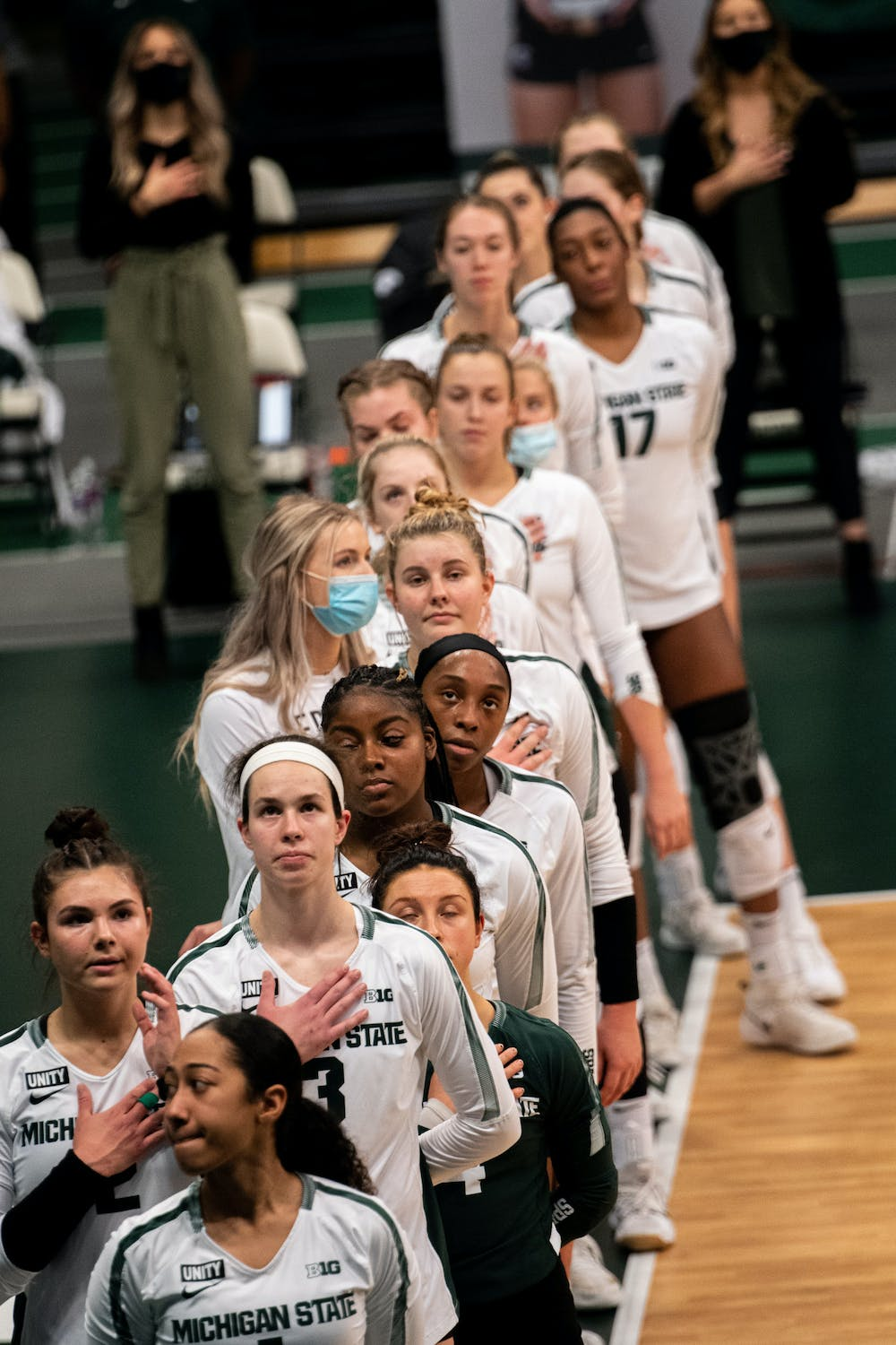 Michigan State Volleyball listens to the national anthem, prior to their loss to Ohio State on Jan. 31, 2021.