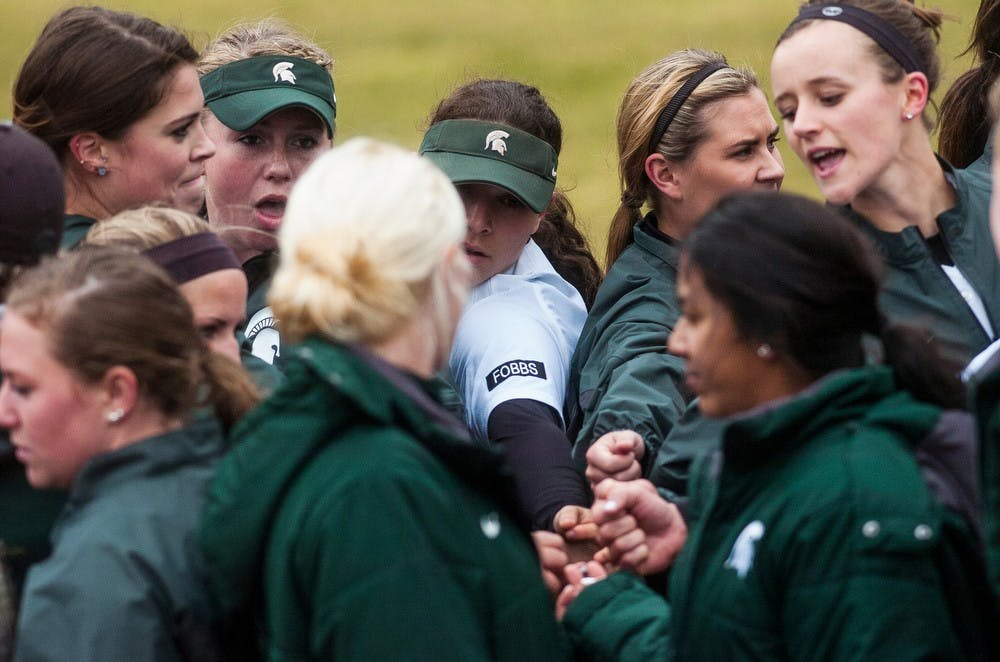 <p>The team puts their hands in together April 4, 2014, before a game against Penn State at Secchia Stadium at Old College Field. The Spartans lost to the Nittany Lions, 9-3. Erin Hampton/The State News</p>