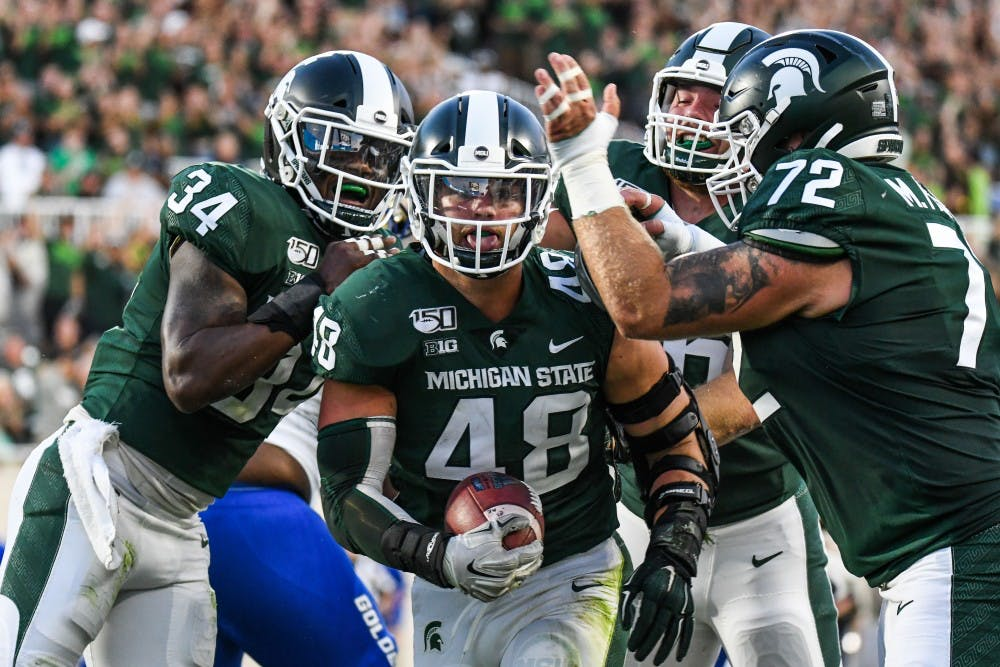 <p>Redshirt senior defensive end Kenny Willekes (48) celebrates after recovering a fumble during the game against Tulsa at Spartan Stadium on Aug. 30, 2019. The Spartans defeated the Golden Hurricane, 28-7.</p>