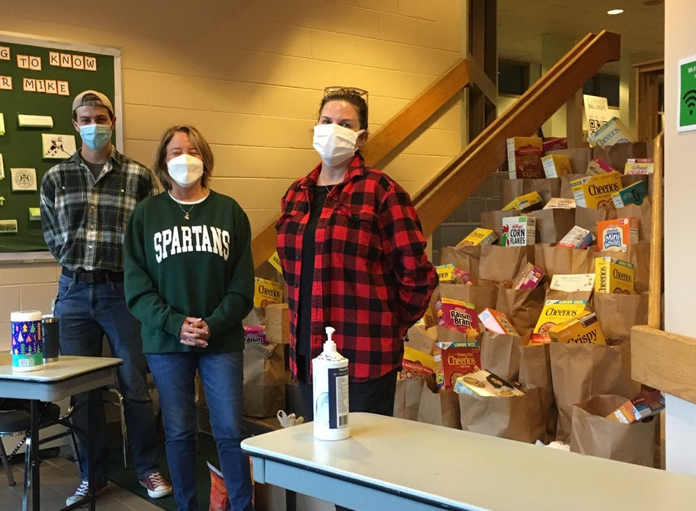 <p>Food Cupboard volunteers prepare bags of groceries for MSU students and EL residents in need. Photo courtesy of Chuck Roboski.</p>