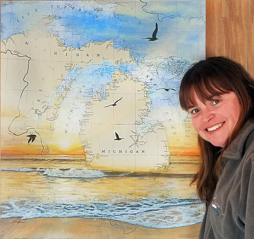 <p>Salina Kalnins is a Michigan-based artist who specializes in nautical chart art. Before it moved online, this would have been her first year at the East Lansing Art Festival. PHOTO COURTESY OF KALNINS</p>