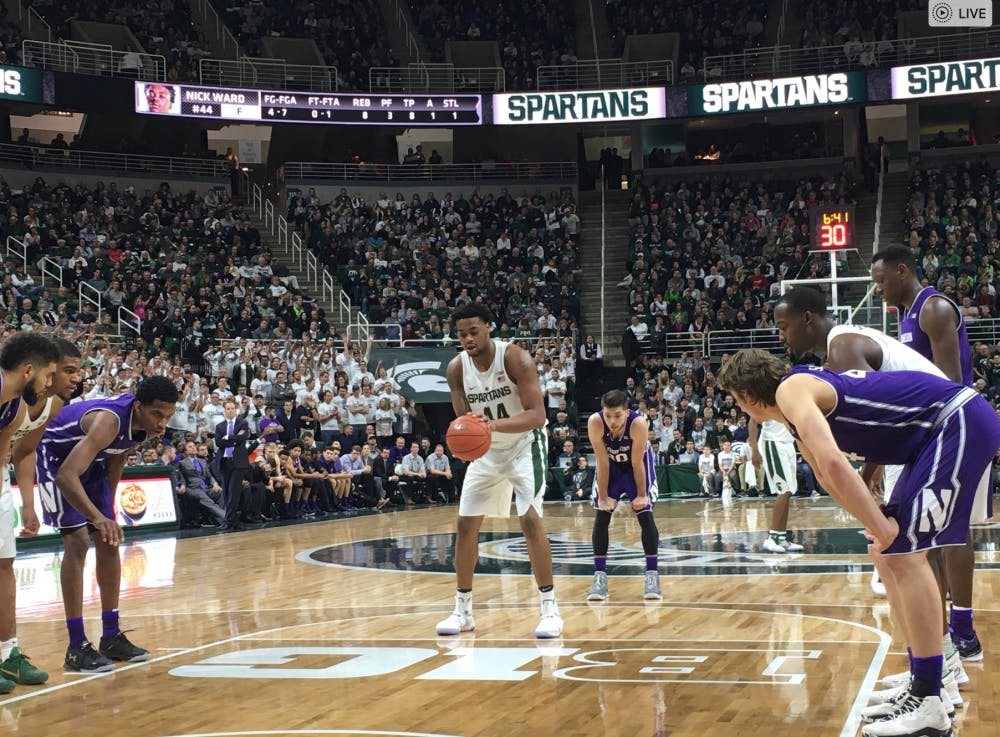 <p>Freshman forward Nick Ward gets ready to take a free throw against the Northwestern University Wildcats on Dec. 30, 2016.</p>