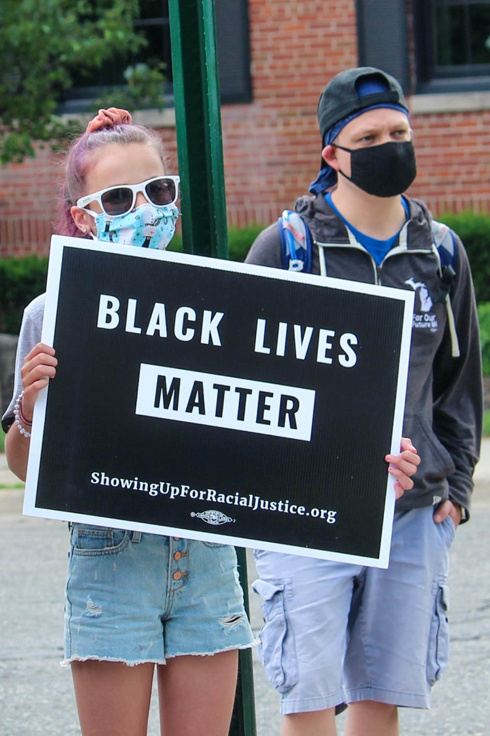 <p>Protesters show their support for Black Lives Matter at March Against Fear on June 24, 2020.</p>