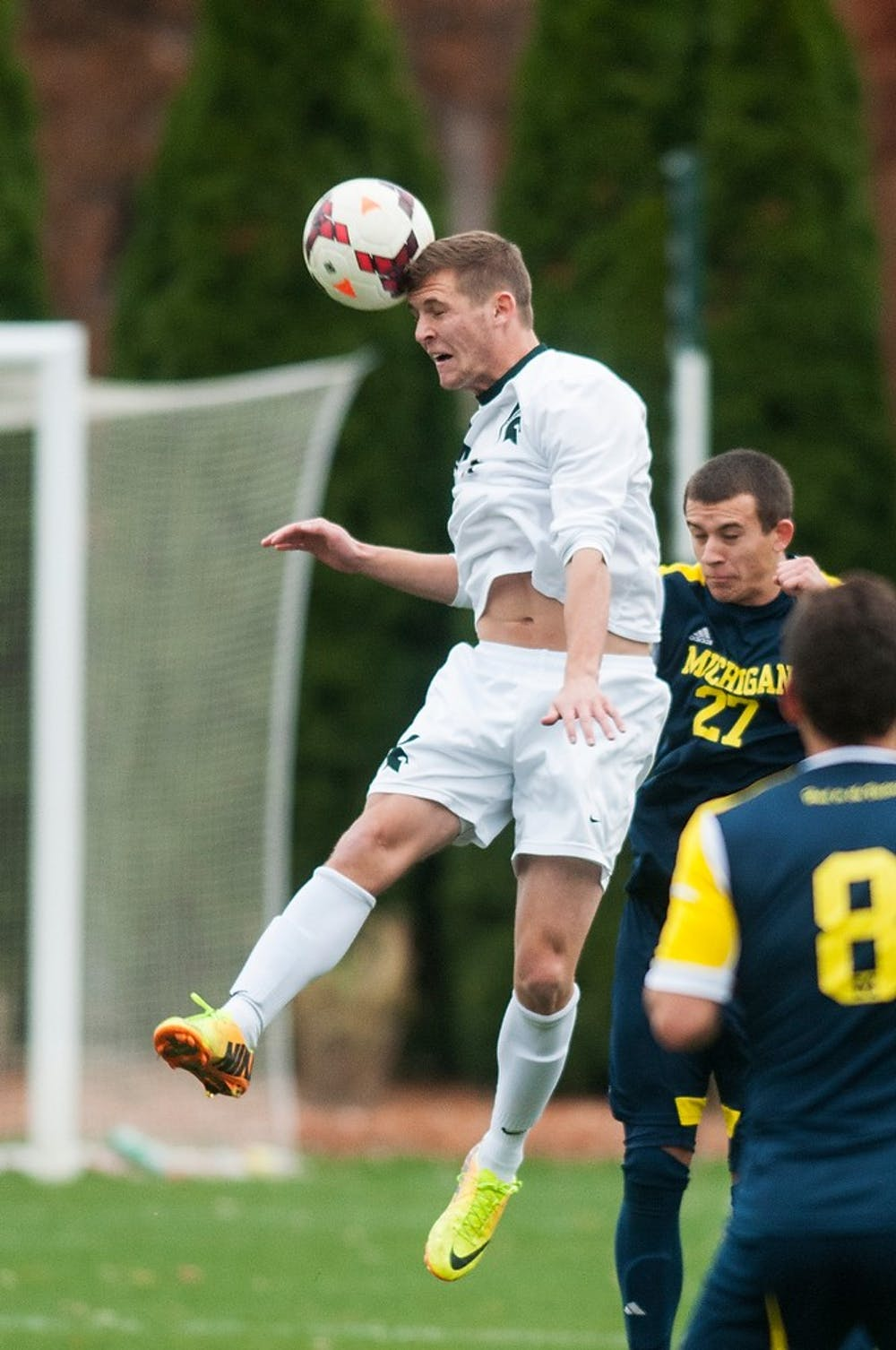 <p>Junior forward Tim Kreutz heads the ball during the game against Michigan on Nov. 9, 2013, at DeMartin Stadium at Old College Field. The Spartans defeated the Wolverines, 2-0. Danyelle Morrow/The State News</p>