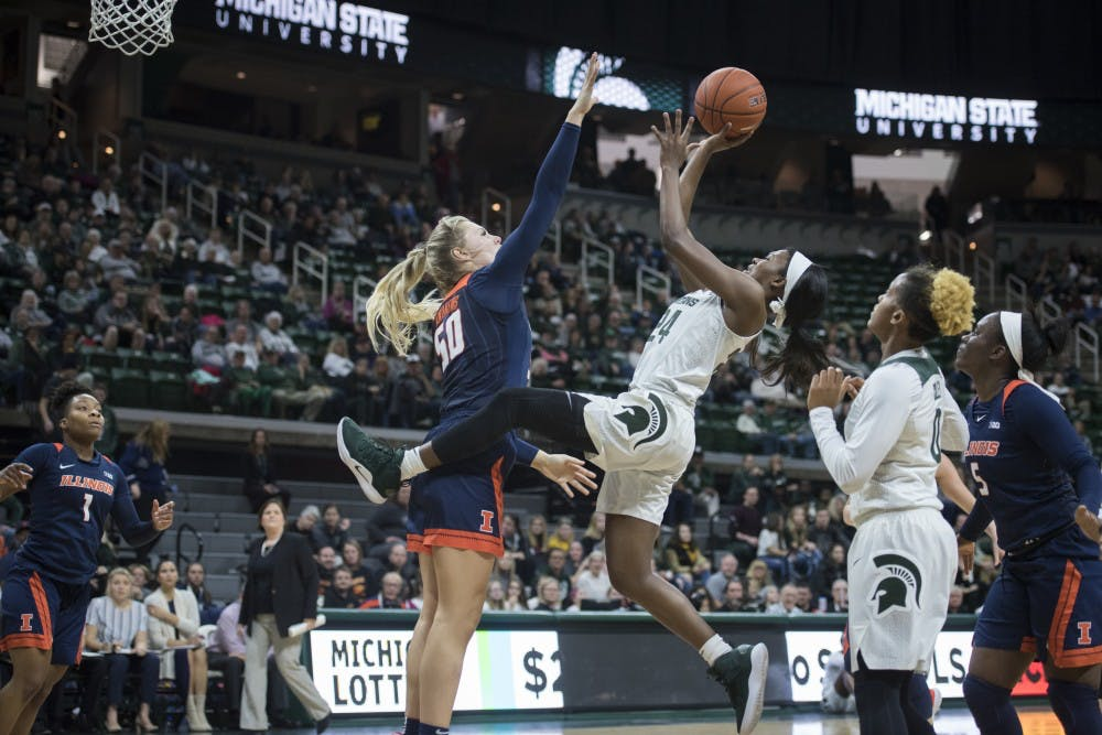 Freshman guard Nia Clouden (24) shoots the ball during the women's basketball game against Illinois at Breslin Center on Jan. 24, 2019. Michigan State defeated Illinois 77-60. Nic Antaya/The State News