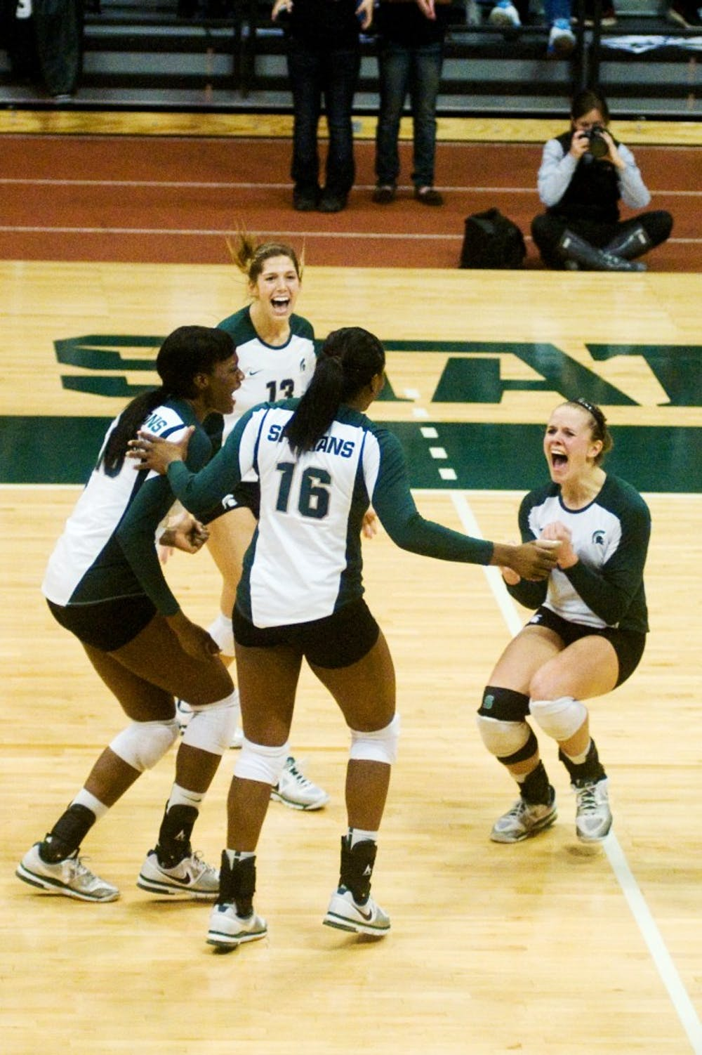 Senior Jenilee Rathje runs over to her team to celebrate a valuable point on Wednesday at Jenison Field House. Each of the four sets played between the Spartans and the Hoosiers were close matches; however, the Spartans brought home a win.